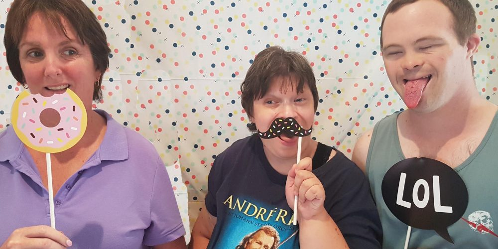 CFN Students with donut, mostache and LOL Props