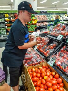 CFN participant shopping for cooking program